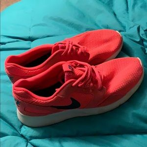 Bright pink Nike shoes